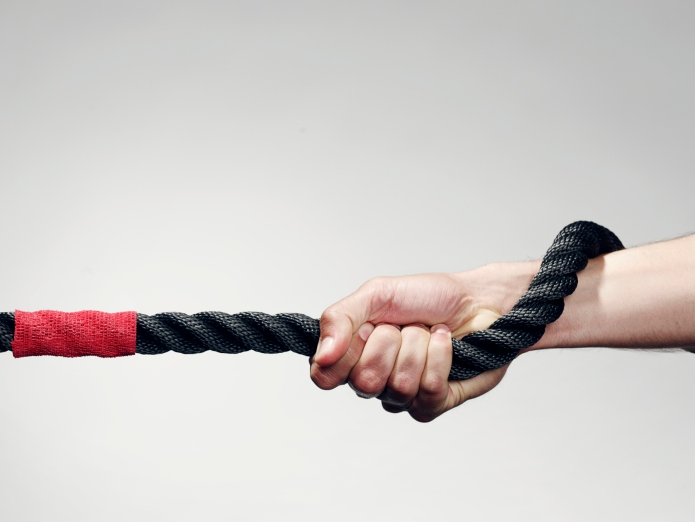 Hand holding rope