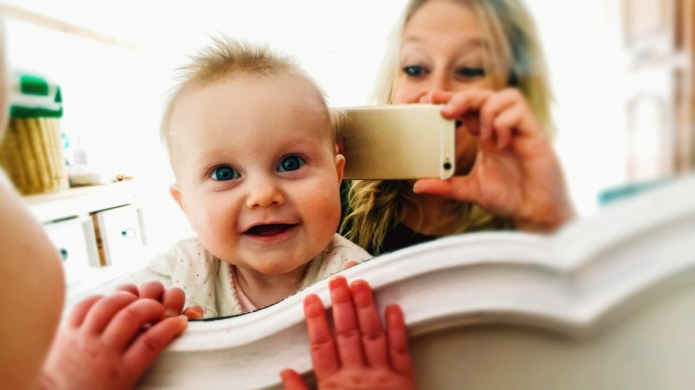 Portrait Of Cute Baby With Mother