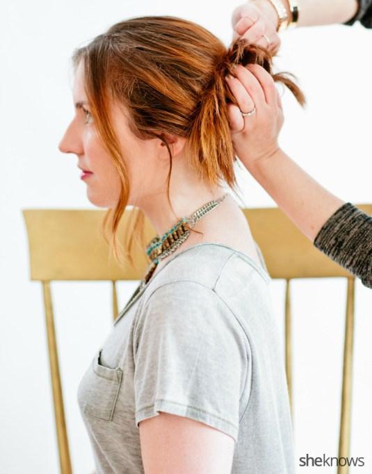 Woman pinning bun hairstyle