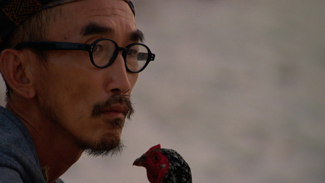 Tai Trang with Mark the chicken on Survivor: Kaoh Rong