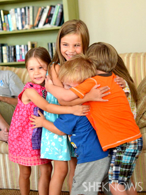 Tamara's son in group hug with friends