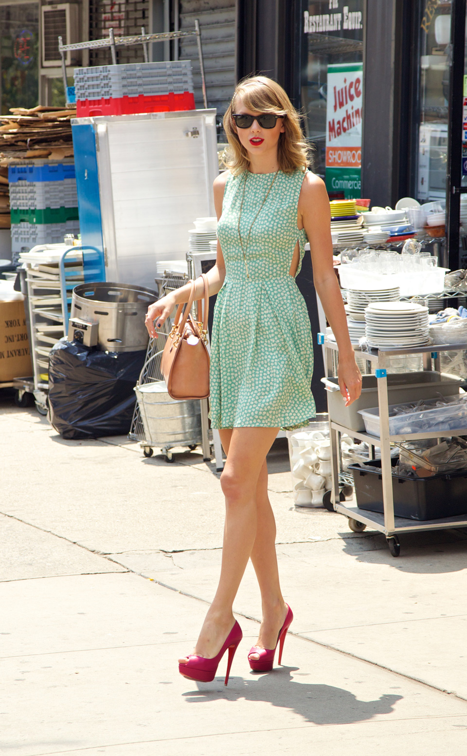 Mint green is one of our fave summer colors, so we were delighted to see TSwift head out in this printed mini dress.