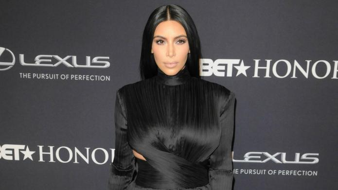 Kim Kardashian strips down, shows off