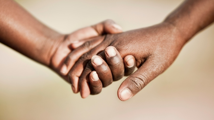 Two African Children Holding Hands