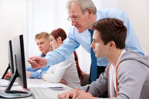 Teen at computer in school
