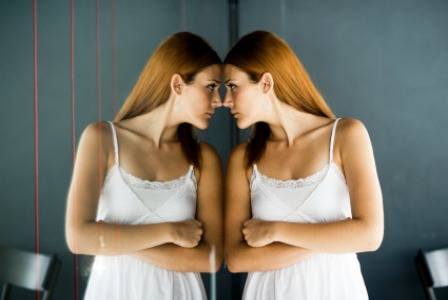 Teen looking in the mirror