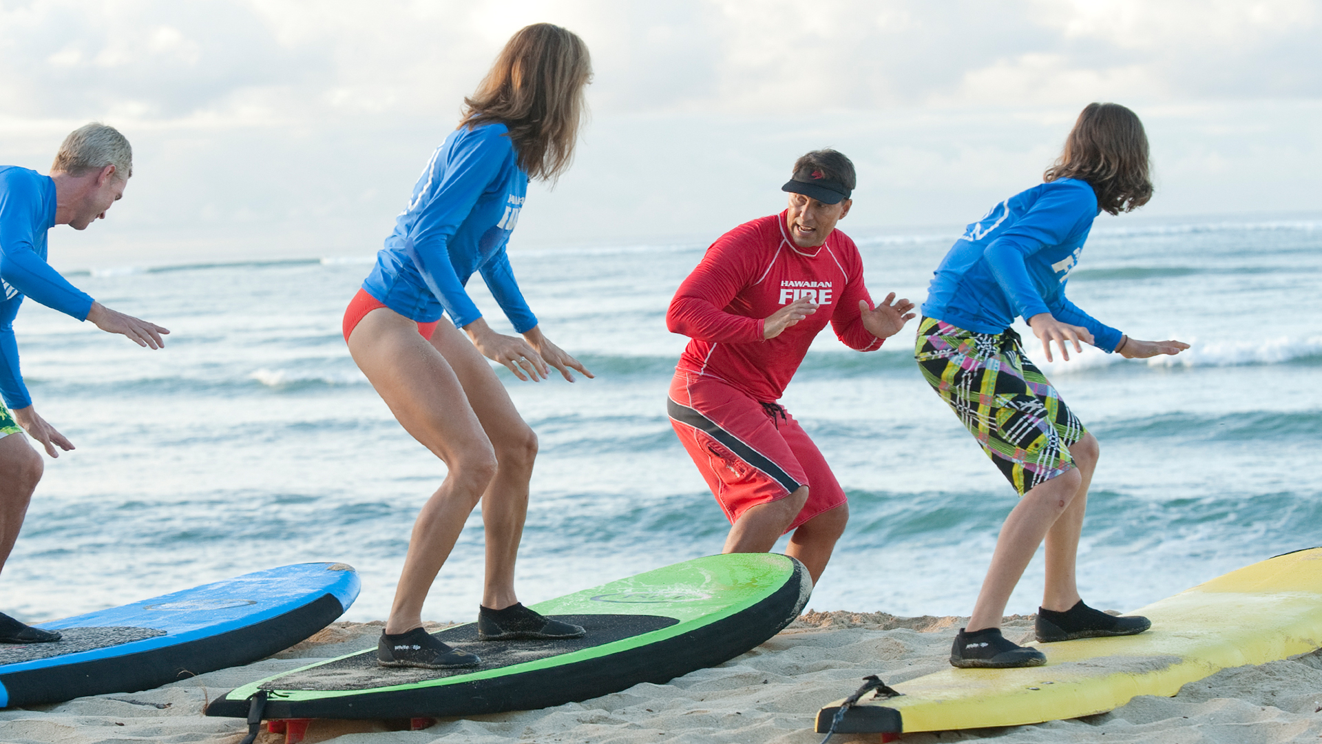 Teens taking surfing lesson | Sheknows.com