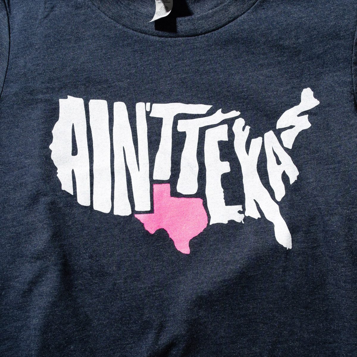 shirt depicts the u.s. with Texas apparent and the rest marked ain't texas