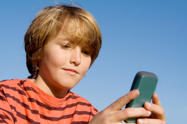 boy sending text messages