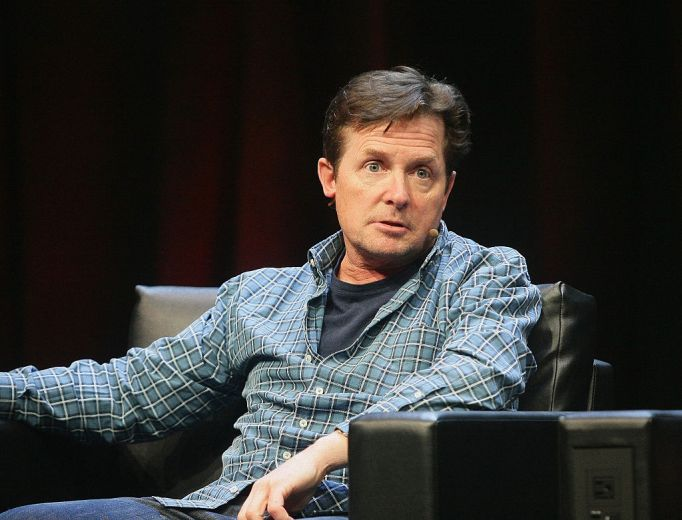 Michael J. Fox in a blue shirt