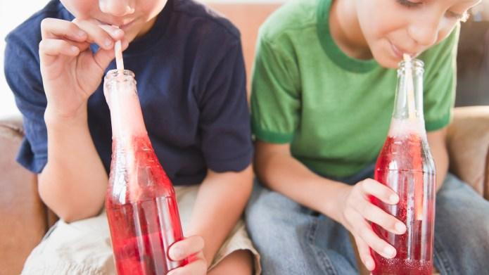 Boys drinking soda together