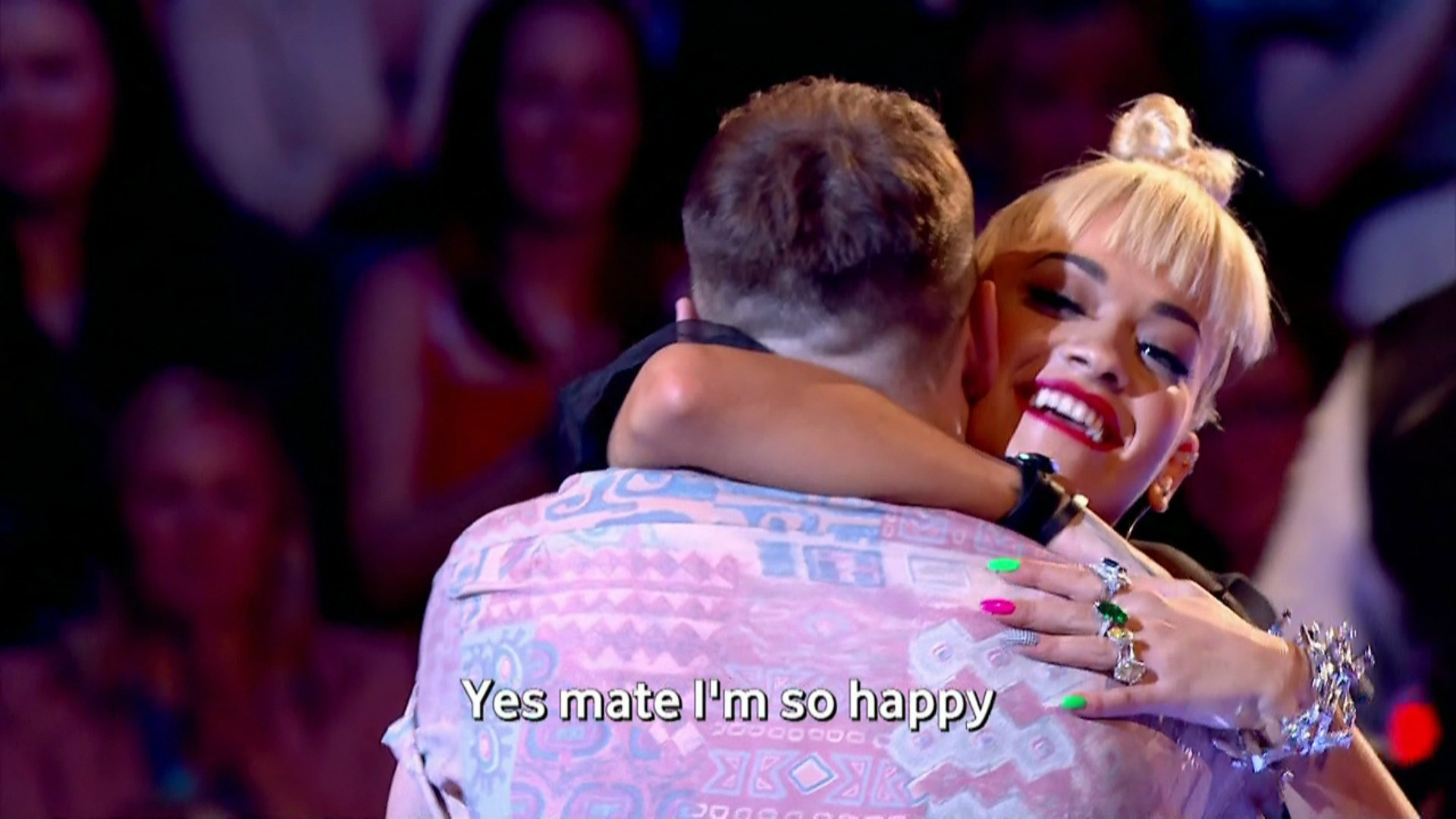 Rita Ora hugs contestant on The Voice UK