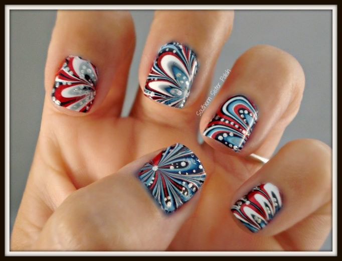 Water marbled 4th of July nail design
