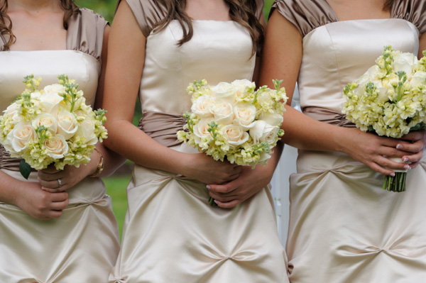 Three bridesmaids with bouquets