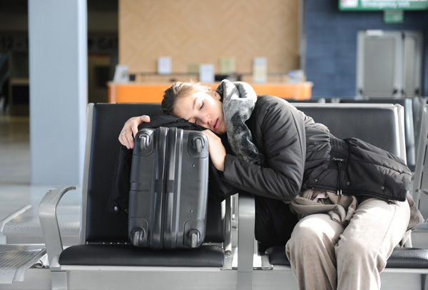 Tired woman at airport