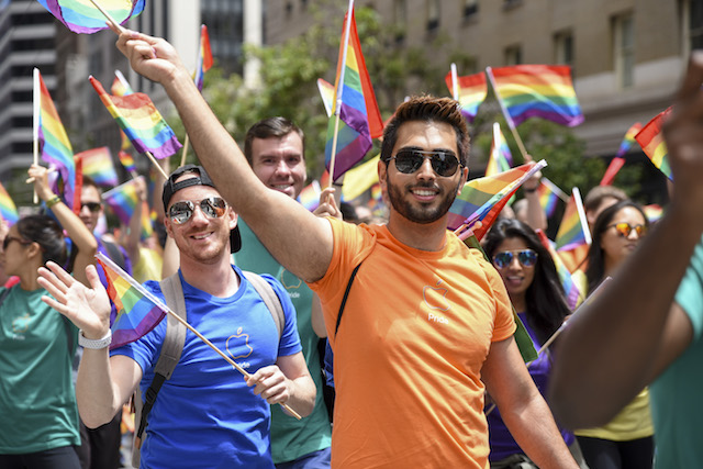 People march with Gay Pride colors during San Francisco Gay Pride parade