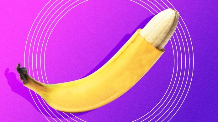 Peeled 'Circumcised' Banana Against Purple Background
