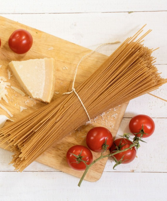 whole wheat pasta on cutting board