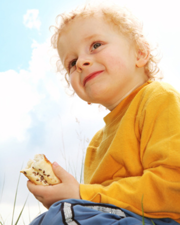 Toddler eating snack | Sheknows.com