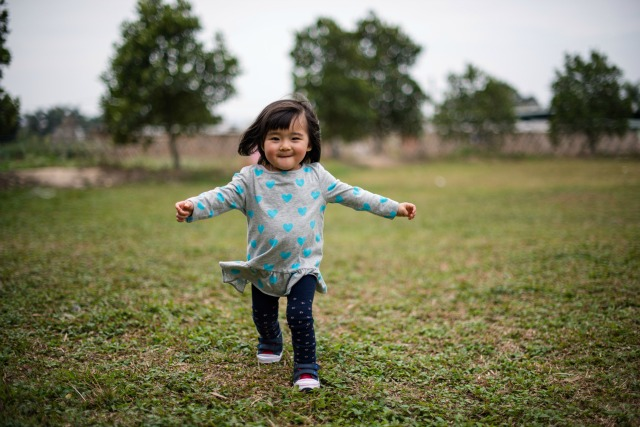 Toddler girl running