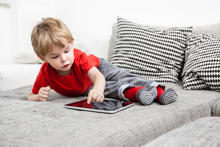 Toddler playing with tablet | Sheknows.com