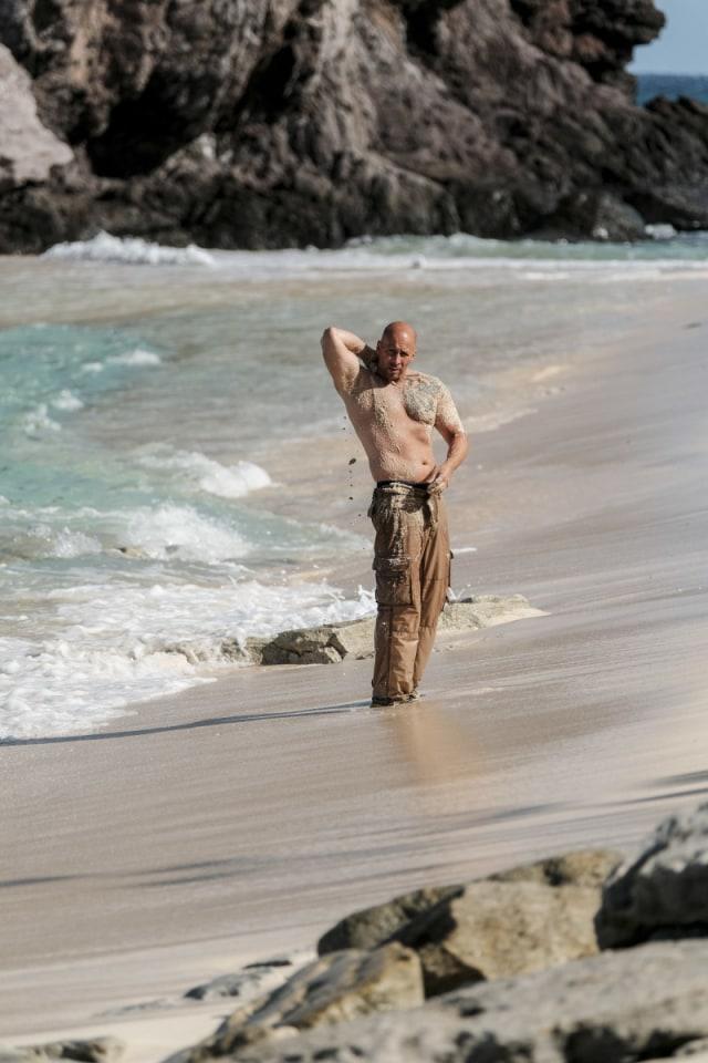 Tony Vlachos walks along Mana beach on Survivor: Game Changers