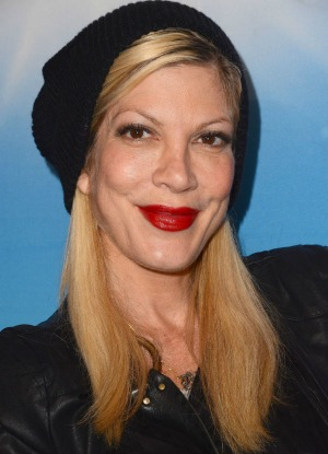 Tori Spelling engaged in feud with former dog walker