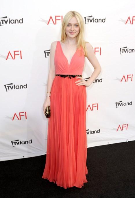 Dakota Fanning in a coral dress