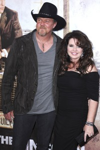 Trace Adkins and hiw wife at The Lincoln Lawyer premiere