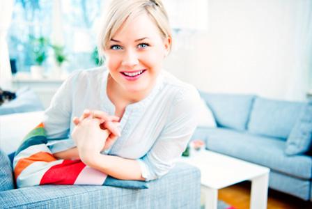 Trendy woman in living room
