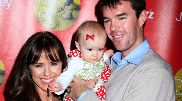 Trista and Ryan Sutter pose with baby Blakesley