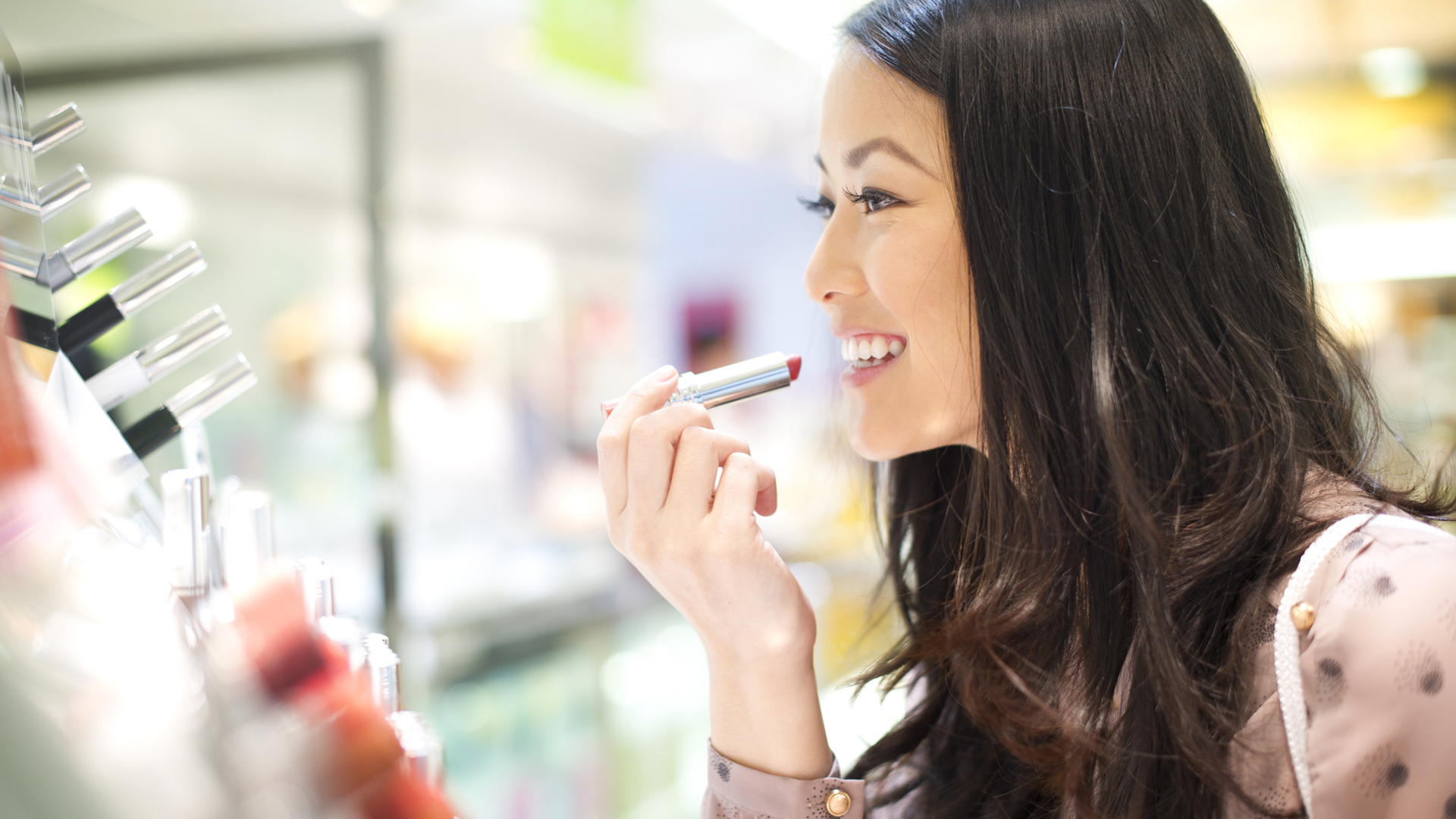 Trying makeup at a store | Sheknows.ca