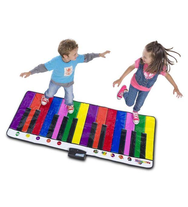 Kids playing on giant rainbow keyboard