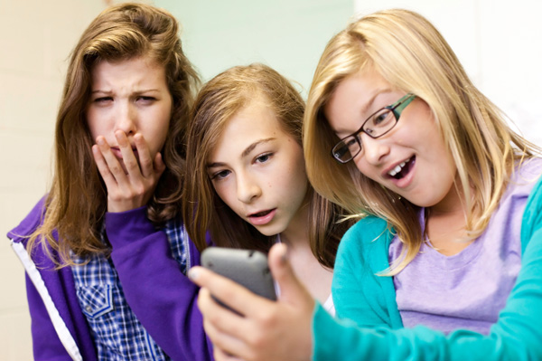 Tween girls on cell phones