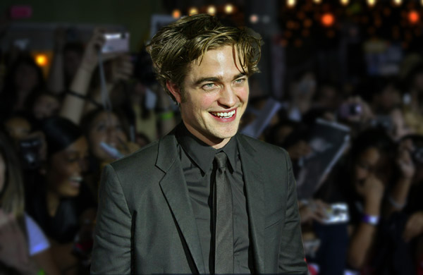 Robert has millions of reason to smile at the Twilight premiere