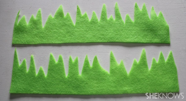 Use scissors to cut the felt into grass