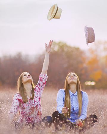 Two women in a spring field | Sheknows.ca