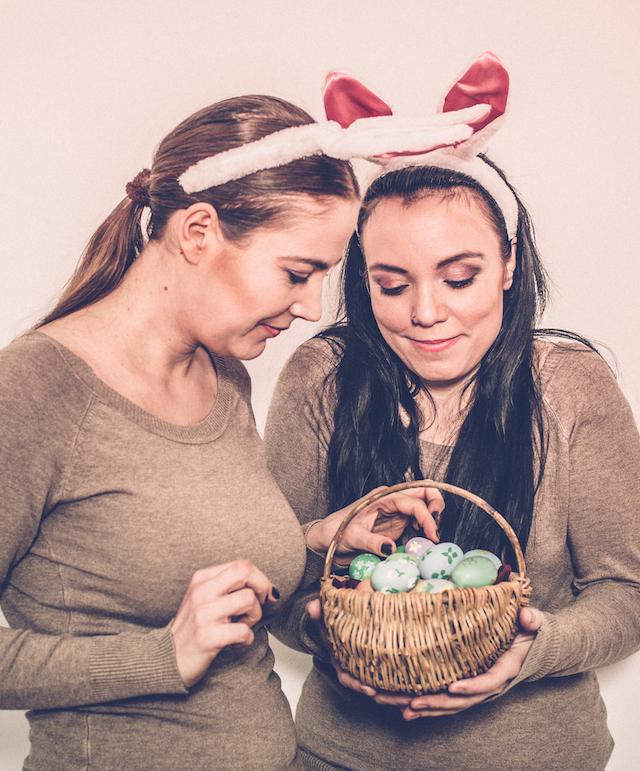 two women holding Easter eggs basket