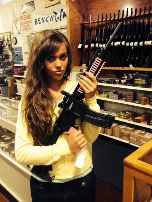 Jessa Duggar holding an automatic rifle