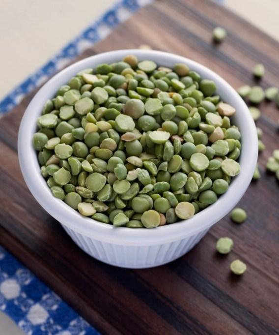 split peas in bowl on wooden cutting board