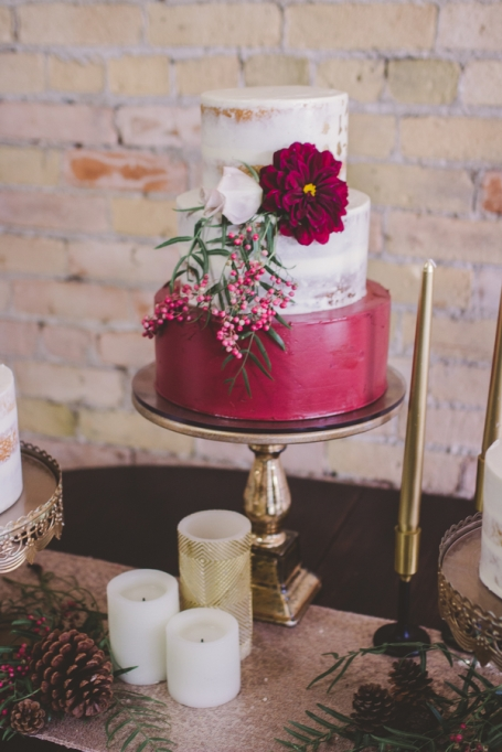 Fall Wedding Cakes: This red and white cake is adorned with a simple blossom