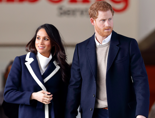 Meghan Markle and Prince Harry leave an event at the Nechells Wellbeing Centre