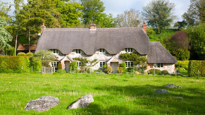 Two historic semi-detached thatched cottages at