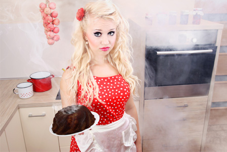 Unhappy woman with burned cake