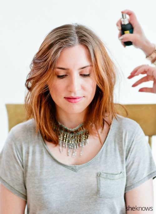 Spraying hair with sea salt spray