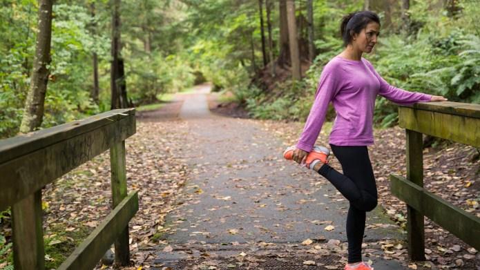 Woman stretching leg preparing for run