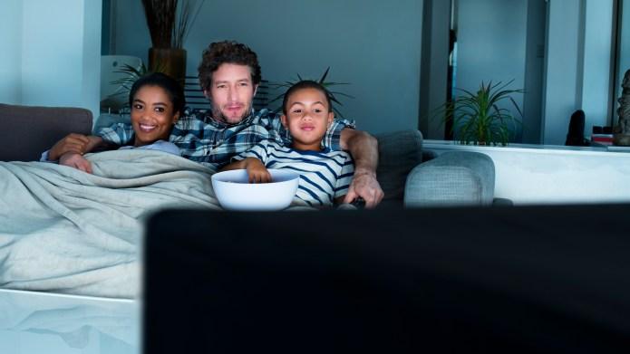Family having popcorn while watching TV
