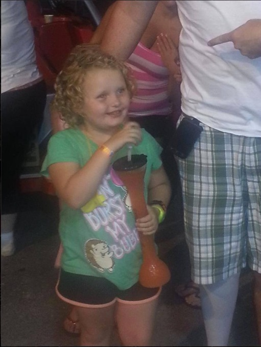 Honey Boo Boo sipping on a yard drink in July 2013