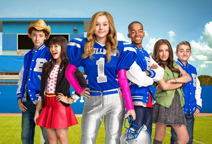 Brec Bassinger as as Bella, a cheerleader-turned-football player