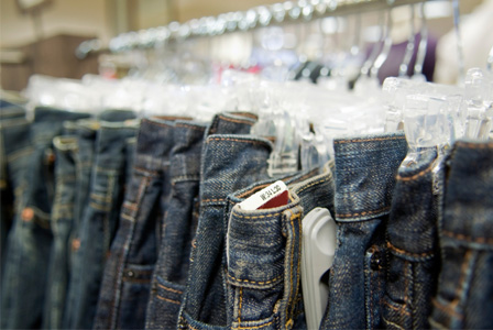Variety of jeans on hangers